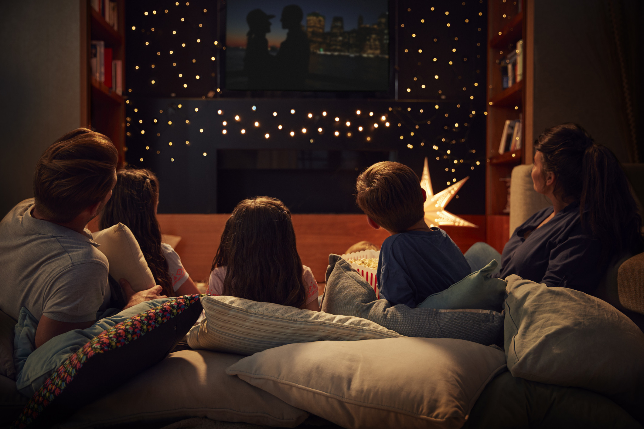 Family watching movie together in living room