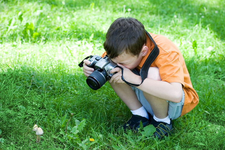 boy taking pictures outside